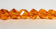 """Helix Crystal Beads 6mm Orange Faceted Twisted Crystal Beads, Chinese Crystal Glass Beads, Polygon Beads on a 7"""" Strand with 33 Beads by BusyBeeBeadSupplies on Etsy"""