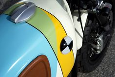 the BMW R60/6 custom motorcycle by vintage steele is a rainbow parade