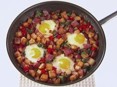 Give your eggs some love and nestle them in Giada's Salami, Bacon and Spinach Hash. To cook the eggs faster, cover the pan with a lid!