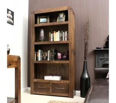 Shiro Walnut Large 2 Drawer Bookcase This chunky Large Shiro Walnut Bookcase offers plenty of display space with two spacious drawers for additional storage. Crafted from solid walnut and featuring stylish antiqued bronze handles, it has been finished in a hard wearing satin lacquer.