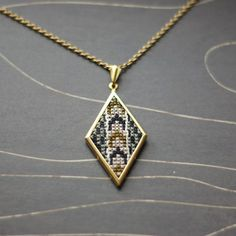 Modern cross stitch necklace/ pendant by TheWerkShoppe on Etsy, $36.00