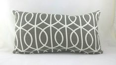 Gray and white geometric lattice cushion cover. Fits a