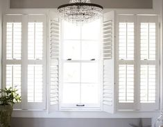 For my Living Room. someday Plantation Shutters Double-hung windows require bifolded plantation shades that can be adjusted separately on the top and bottom. Double Hung Windows, Windows And Doors, Double Window, Window Coverings, Window Treatments, Interior Window Shutters, Interior Doors, Bedroom Shutters, White Shutters