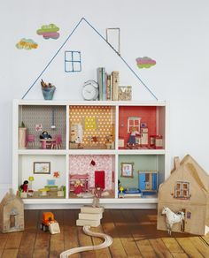 Dollhouse made from bookshelf - nice because it has higher ceilings than most (ie, easier to play with).
