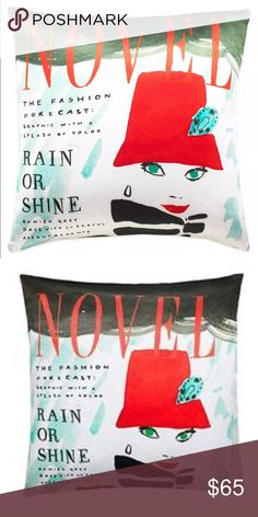 """Kate Spade ♠️ Beautiful Kate Spade Rain or Shine decorative toss pillow. This whimsical pillow features a signature Kate Spade illustration of  a woman in a red hat on a white background. It has the word, """"Novel,"""" in red across the top and  a book title, """"Rain or Shine,"""" in black along the left side of the pillow. The pillow has accents in aqua and green. The pillow would make a great accent piece on a sofa, chair, or bed. measures 20"""" x 20"""". 51% silk and 49% cotton so it has a silky feel…"""