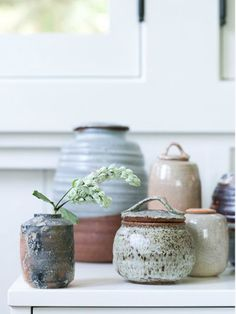 Mt. Washington Pottery. I like the small lidded jar almost hiding behind the jar in the foreground.