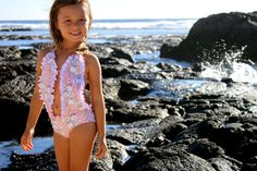 Hands down one of our best sellers. Feminine and fun this one piece is always a favorite for the beach or pool. Who can pass up a bunch of ruffles? XS = Newborn - 1 Year S = 1- 2 Years M = 2 - 4 Years
