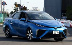 A Toyota Motor Corp. Mirai is driven during a test drive in Tokyo in November. Hydrogen Powered Cars, Hydrogen Car, Fuel Cell Cars, Driving Test, Toyota, Trucks, Japan, Vehicles, November