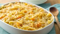 Bow-tie pasta pairs with winter squash and parmesan cheese for a creamy flavorful casserole.