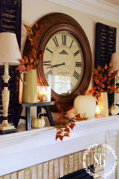 EASY FALL MANTEL 2 | The clock stayed, the shutters and lamps too. These large pieces anchor the whole mantel. I think anchor pieces should be big so they can be seen. My clock and chippy shutters fill the wall space between the top of the mantel and the crown molding. | Another defalt on my mantel are the cream colored pitchers. I removed one and added sprigs of faux fall leaves to the others.