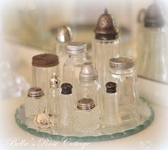 love the grouping of salt and pepper shakers from Bella's Rose Cottage.