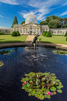 The Venus Statue overlooks a lilly pond in front of the Great Conservatory in Syon Park - London