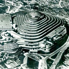 Standing out against surrounding shanties in Caracas, El Helicoide spirals skyward like a modern Tower of Babel. It was designed to be a drive-in shopping center with motorists cruising up and parking in front of stores — a kind of strip mall in the sky. It was in many ways a product of its times: a 1950s