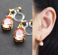 Dangle teardrop orange cubic zirconia invisible clip on earrings by MiaybiGrace  These invisible clip on earrings are made from resin and comfortable to wear. You can wear them for straight 8 hours. And moreover, earring backs are clear, so they are look