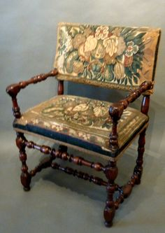 "Extremely Rare Early 17th Century Louis XIII Period Armchair. The low rectangular back references a style of chair that evolved at the end of the 16th century. The elegant turned arms and legs with high stretchers are Circassian Walnut that has a lustrous color and rich glowing patination , upholstered with period tapestry. Made in France circa 1630. H x 37""W x 25"" D x 18"""
