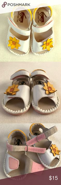 🌼 See Kai Run Flower Sandals Adorable white leather sandals by See Kai Run. These have never been worn. Perfect condition. The leather flower is slightly curled up, and arrived that way when purchased online. Size toddler 7, but runs large. See Kai Run Shoes Sandals & Flip Flops