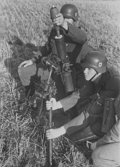 SS soldiers preparing to open fire from 81-mm mortar shells during the invasion of Poland
