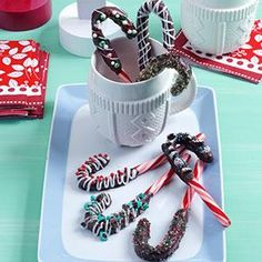 Chocolate-Dipped Candy Canes Recipe from Taste of Home -- shared by Sandra Baumgarten of Vancouver, Washington (Hard Christmas Candy) Hard Christmas Candy, Holiday Candy, Christmas Snacks, Christmas Cooking, Noel Christmas, Holiday Treats, Christmas Recipes, Christmas Goodies, Christmas Ideas