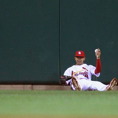 ST. LOUIS, MO - SEPTEMBER 18: Jon Jay #19 of the St. Louis Cardinals shows the ball after catching a deep fly ball against the Houston Astros at Busch Stadium on September 18, 2012 in St. Louis, Missouri. (Photo by Dilip Vishwanat/Getty Images)