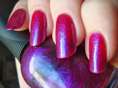 Purple Poodle is a bright magenta jelly with fine blue shimmer and a scattering of purple flakes.