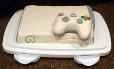 xbox 360 cake...the controller was rice krispie treats! John would love this cake, wonder if 10th street could make it!lol
