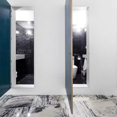 Five hand-painted doors, each in a different shade of blue, punctuate the curved wall, leading to the bathrooms, two bedrooms and stairwell