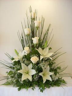 Symmetrical floral arrangement containing white roses Arrangements Funéraires, Funeral Flower Arrangements, Beautiful Flower Arrangements, Beautiful Flowers, Floral Arrangement, Simply Beautiful, Beautiful Pictures, Altar Flowers, Church Flowers
