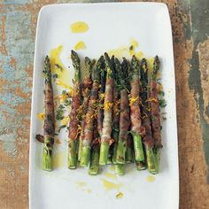 Pancetta-Wrapped Asparagus with Citronette | In #MarioBatali's riff on the traditional antipasto of prosciutto-wrapped asparagus, he wraps spears in pancetta and grills them.