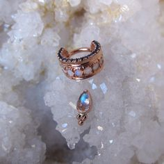 """perrymdoig: """"These beauties jus arrived in the mail, along with another massive order of gold adornments from @bvla. Pictured is a rose gold, AAA white opal and AA London blue topaz """"Tiara,"""" and a rose gold and rainbow moonstone pear bezel with a..."""