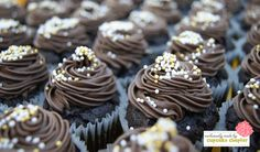 Moist dark chocolate cupcakes with traditional dark chocolate fudge. To die for!