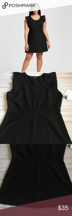 Victoria Beckham For Target Little Black Dress 3X New with tags Victoria Beckham For Target size 3X little black dress with ruffles around the arms.  The dress is 48% polyester 46% nylon and 6% spandex. Victoria Beckham for Target Dresses Midi