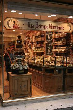 Chocolate fountain in Brussels, Belgium. Chocolate store La Belgique Gourmande, Belgian gastronomy