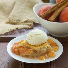 Classic peach cobbler with a scoop of vanilla ice cream