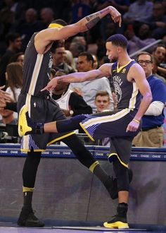 Javale McGee and Stephen Curry of the Golden State Warriors