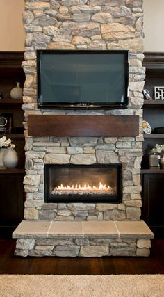 I like this as a half wall fireplace wood storage under for Fireplace half stone