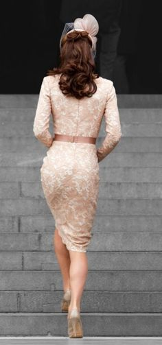 Catherine, Duchess of Cambridge in a blush lace Alexander McQueen dress with silk belt and Jane Taylor hat.
