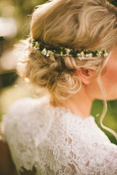 Loose curled up do + tiny dried daisies at the nape. Love!   Read More: http://www.stylemepretty.com/2014/07/28/rustic-southern-wedding-at-the-horse-farm/