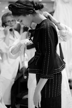 Behind the scenes in Diors Haute Couture ateliers during  final fitting just a few hours before the  Spring Summer 2012 Haute Couture show.