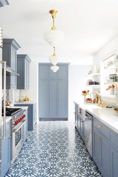 Forget hardwoods: We're floored by the tile floor in this blue kitchen. The chic arabesque pattern gives the space instant wow factor while also creating a tight color story with matching gray-blue cabinets.