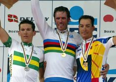 The wounded Lion King - News breaks in Italy that #MarioCipollini was a client of #DrFuentes! #2002Worlds: The elite men's podium (L-R) of Robbie McEwen (Australia), Mario Cipollini (Italy) and Erik Zabel (Germany)