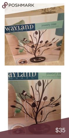 Jewelry Tree Jewelry Tree This uniquely beautiful stand is hand crafted to safely hold all your rings, necklaces, earrings, bracelets and other adornments. The circular base features a built in tray to keep loose rings, pins, bracelets and other jewelry. wayland square Jewelry