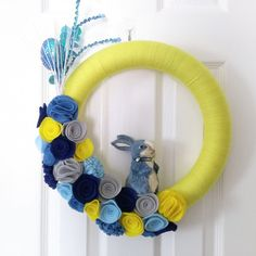 Yellow Easter Bunny Yarn Wreath with blue, yellow, gray felt flowers and sequined Easter egg spray!  #buynow for $45 on inselly.com