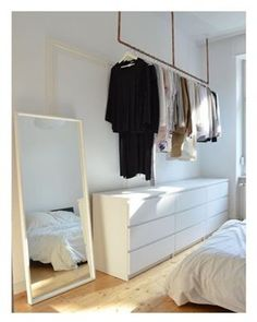 Idea for open wardrobe. Hanging up clothes without wardrobe – hanging clothes rail above the dresser to hang clothes. clothes hanging # The post Idea for open wardrobe. Clothes hanging … appeared first on Woman Casual. Industrial Closet Organizers, Hanging Clothes Rail, Clothes Rack Bedroom, Diy Clothes, Clothes Racks, Casual Clothes, Fashion Clothes, Industrial House, Industrial Chair