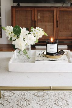 home accents decorative Perfect Home Accent: White Marble Tray - Harlowe JamesHarlowe James Coffee Table Styling, Decorating Coffee Tables, Coffee Table Tray Decor, How To Style Coffee Table, Coffee Table Decorations, Coffee Table Flowers, Serving Tray Decor, Coffee Tray, Tray Styling
