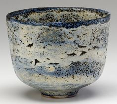 "NATZLER Earthenware bowl covered in blue and white ""crater"" glaze."