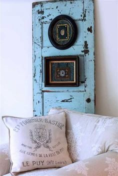 recycling old wooden door into blue painted and decorated wall craft with picture frames