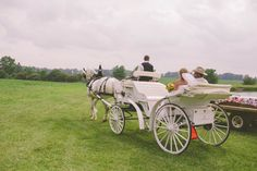 leaving wedding in a horse drawn carriage