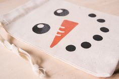 Create this easy snowman gift bag craft yourself!