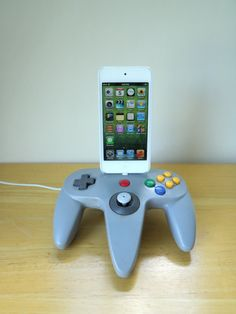Tap into your gamer side with this N64-themed iPhone dock.