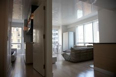 high gloss white plaster ceiling reflecting the outside.